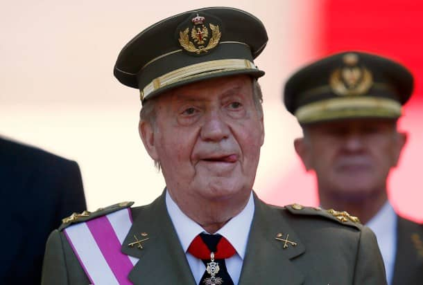 Spain's King Juan Carlos gestures during celebrations marking Spain's Armed Forces Day in Madrid