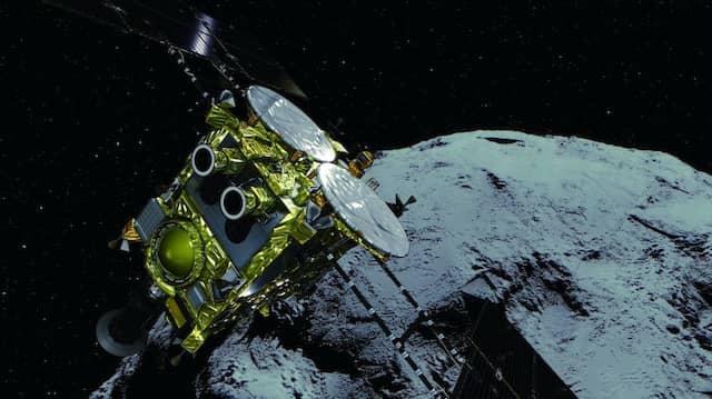 Die japanische Raumsonde Hayabusa2 und ihr Zielobjekt,  der Asteroid Ryugu, in einer Illustration