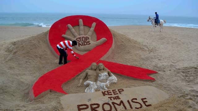 Der Kampf gegen Aids wird an vielen Fronten geführt – hier 2013 an einem Strand in Indien.