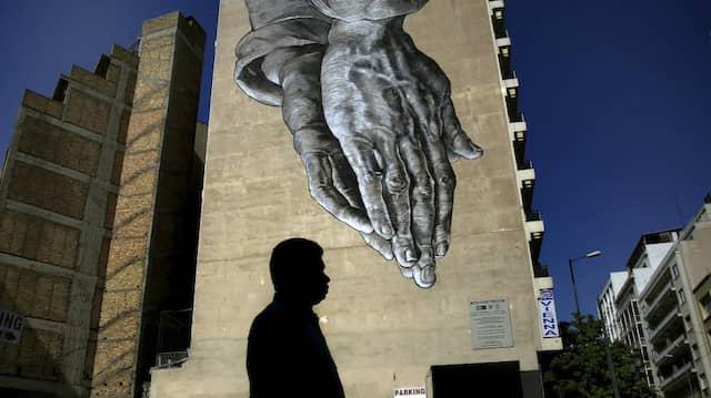 Bittende Hände: Graffiti in Athen.