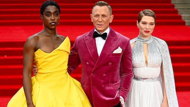 In (wein)rot auf dem roten Teppich: Daniel Craig (Mitte) umrahmt von den beiden Schauspielerinnen Lashana Lynch (l.) und Léa Seydoux.