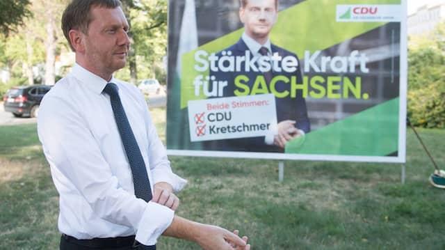 Ist mit seiner Partei in den Umfragen zur Sachsen-Wahl zur Zeit stärkste Kraft: CDU-Ministerpräsident Kretschmer