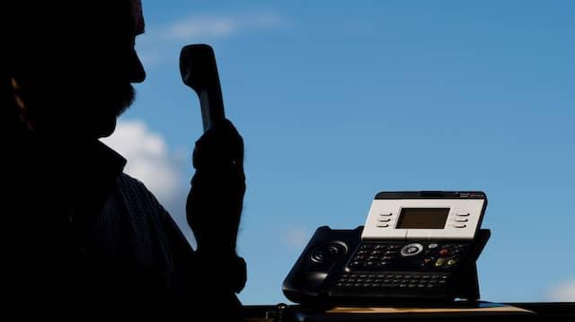 Betrug: Die Beschuldigten gaben sich am Telefon als Polizeibeamte aus (Symbolbild).