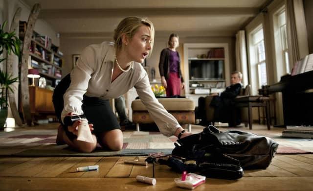 """Szene aus Roman Polanskis Verfilmung von """"Der Gott des Gemetzels"""" mit Kate Winslet (im Vordergrund), Jodie Foster und Christoph Waltz"""