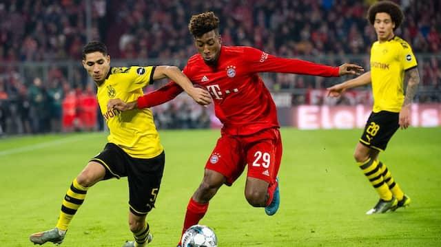 Wer gewinnt? Achraf Hakimi von Dortmund (links) und Kingsley Coman vom FC Bayern München kämpfen im vergangenen November um den Ball.